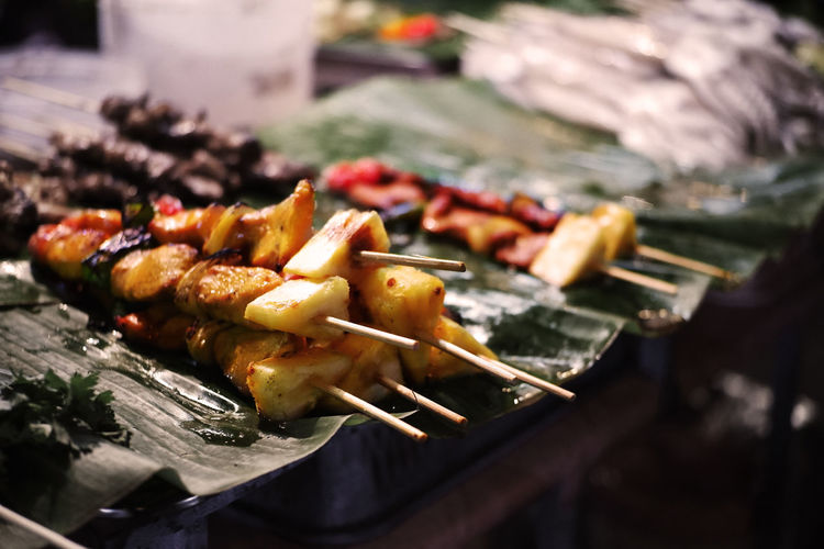 High angle view of meat on skewers in plate