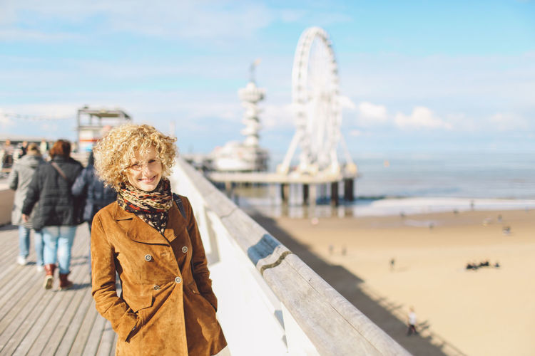 Adult Adults Only Beach Beautiful People Beauty Blond Hair Curly Hair De Pier Ferris Wheel One Person One Woman Only One Young Woman Only Only Women Pier Portrait Reuzenrad Sea Tourism Tourist Travel Travel Destinations Vacations Winter Women Young Adult