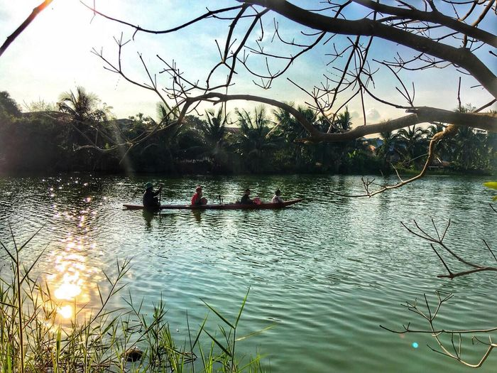 Water Tree Real People River Nature Leisure Activity Outdoors Day Men Beauty In Nature Lifestyles Togetherness Sky Rowing Adult People