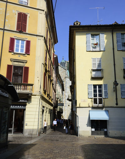 Duomo Alley Architecture Building Building Exterior Built Structure City City Life Day Direction Duomo Di Como Footpath Nature No People Outdoors Residential District Shadow Sidewalk Sky Street Sunlight Window My Best Travel Photo