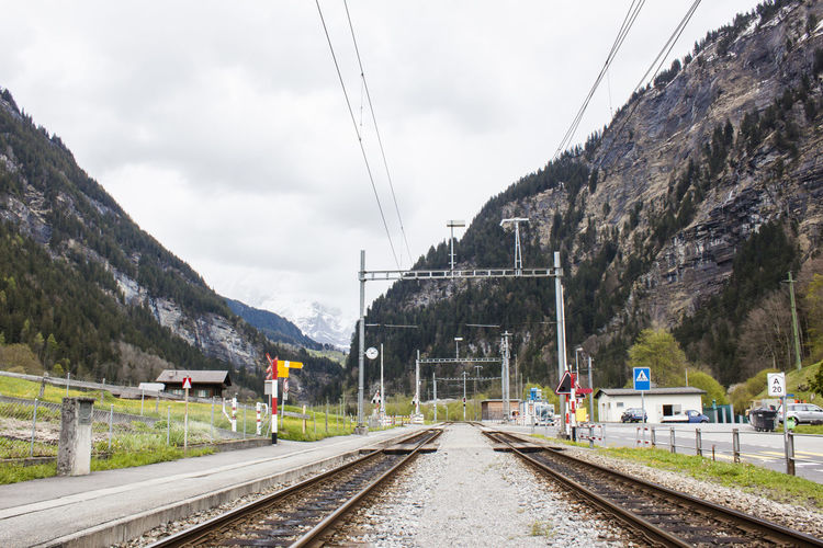 Transportation Sky Rail Transportation Track Railroad Track Mountain Mode Of Transportation Cloud - Sky Nature Cable Day Travel The Way Forward Public Transportation Mountain Range Outdoors Power Line  No People Diminishing Perspective