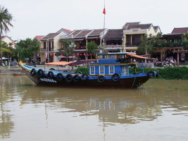Boat on Thu Bon River Architecture Boat Building Exterior Built Structure City Colourful Composition Day Flag Hoi An Incidental People Mode Of Transport Nautical Vessel Outdoor Photography Reflection River Thu Bồn River Tourism Tourist Attraction  Transportation Trees Vietnam Water Waterfront White Clouds