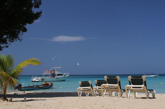 Beach in Negril, Jamaica Beach Life Bloody Bay Caribbean Sea Negril Negril, Jamaica Deck Chairs Jamaica Parish Westmoreland