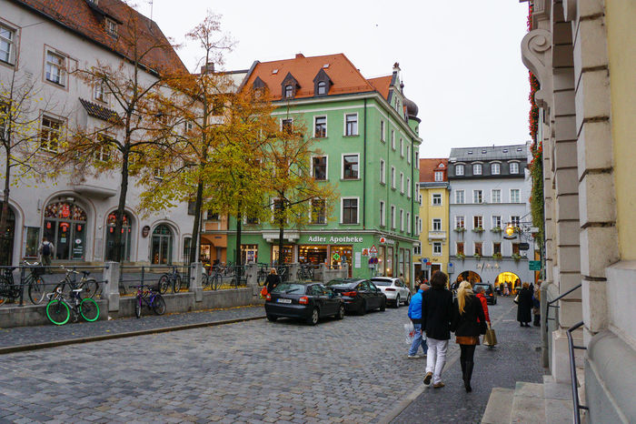 Regensburg, Germany Architecture Building Building Exterior Built Structure City City Life City Life City Street City Street Cityscapes Day Germany Group Of People Leisure Activity Lifestyles Medium Group Of People Outdoors Regensburg Residential Building Residential Structure Road Sky Street The Way Forward