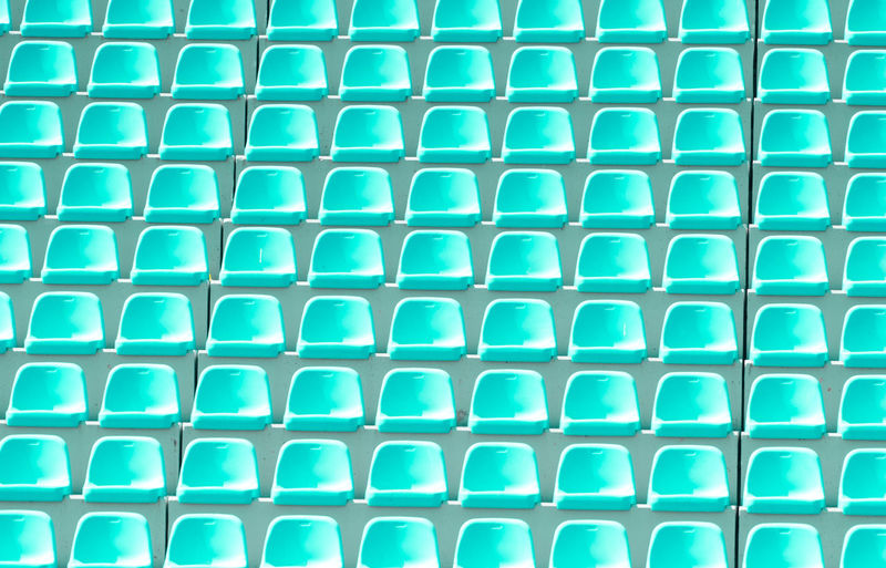 Empty green plastic chairs in a row at the football stadium Empty Stadium Chair Background Competition Sport Game Play STAND Concert Fans Team Seat Plastic Blue Row LINE Pattern Arena Section Playground Field Theater Club Championship Cup Ground Light Rendering Lamp Electricity  Green Soccer Football Shiny Win Summer Power Floodlit Number Audience Tribune Grand Floodlight Colorful Visit Texture Abstract Spectator Backgrounds Full Frame Repetition No People Side By Side Close-up In A Row Shape Large Group Of Objects Design Indoors  Textured  Geometric Shape Order Green Color High Angle View Turquoise Colored Blue Background
