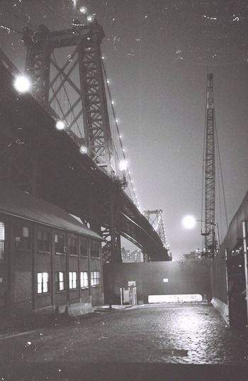 Low angle view of illuminated bridge