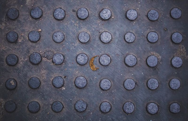 Steel manhole cover Steel Matel No People Close-up Full Frame Backgrounds Metal Textured  Day Outdoors Circle Pattern Shape