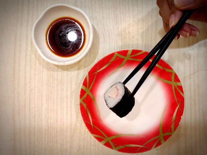Sushi with chopstick Sushi Sushi Time Raw Food Raw Food Photography Food Food Photography Sushi Dinner Background Instagood Homescreen Soy Sauce Sweet Sauce Japanese Food Japanese Meal Japanese Delicacies Japanese Sushi Chopsticks Eating Sushi Japanese Restaurant Asian Food EyeEm Selects Human Hand Drink Red Table Close-up Food And Drink Saucer Beverage Served