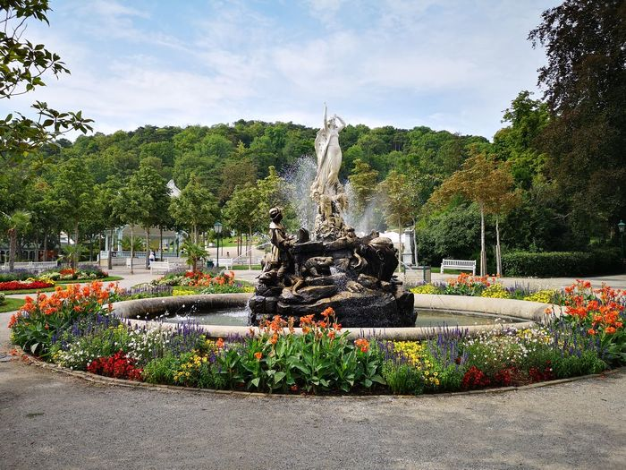 View of fountain in park against sky