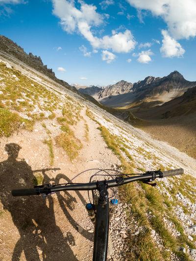 Gopro first person view mountain biking on footpath in the swiss alps, lenzerheide, switzerland.