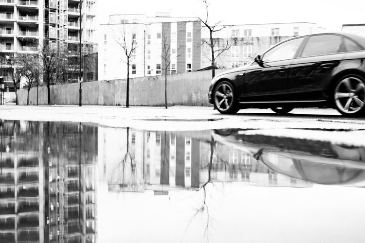 Where this begins Fujifilm_xseries Streetphotography London Car Mode Of Transportation Motor Vehicle Transportation Reflection Land Vehicle Architecture City Built Structure Building Exterior Winter Street Water Day Cold Temperature Road Snow Nature No People
