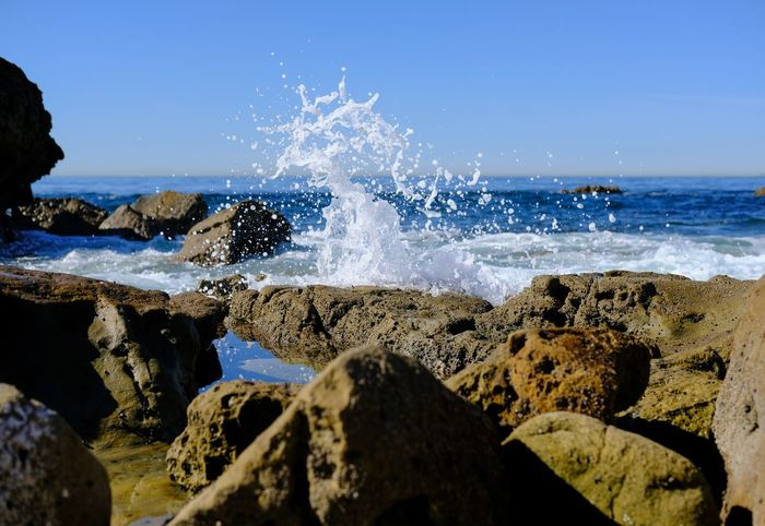 Water Wave Power In Nature Sea Beach Motion Crash Clear Sky Rock - Object Splashing