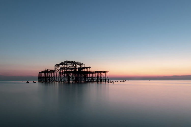 Brighton Brighton Beach Brighton Pier Pier Ruins Long Exposure Water Sea Tranquil Scene Waterfront Beauty In Nature Outdoors Reflection Sunset No People Tranquility Scenics - Nature