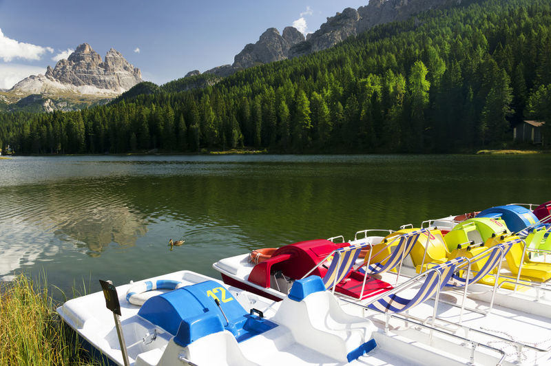 High angel view of boats moored on lake at tre cime di lavaredo against dolomites