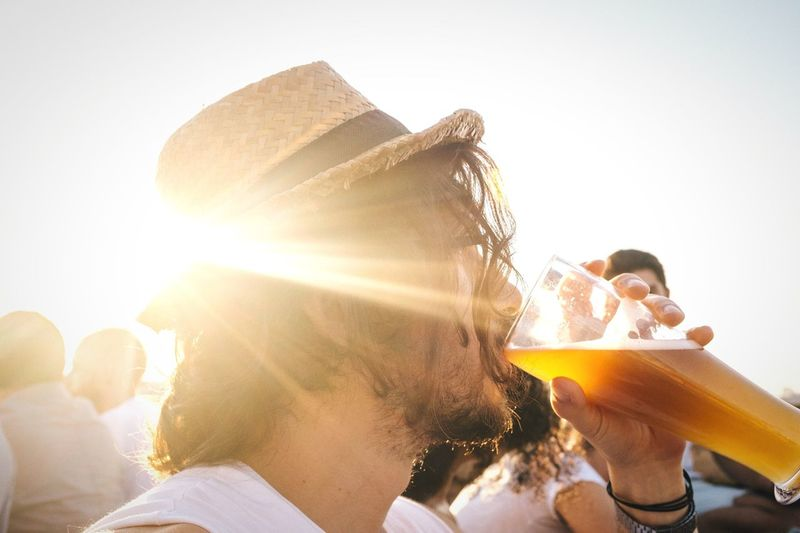 🍺:30 Open Edit Sunbeam Sunlight Headshot Young Adult Lifestyles Leisure Activity Sun Close-up Holding Lens Flare Back Lit Man Profile Young Men Human Face Person Beer Drinking Thirsty  Eyeemphoto Color Palette Alcoholic Drink Drinking Beer Drink