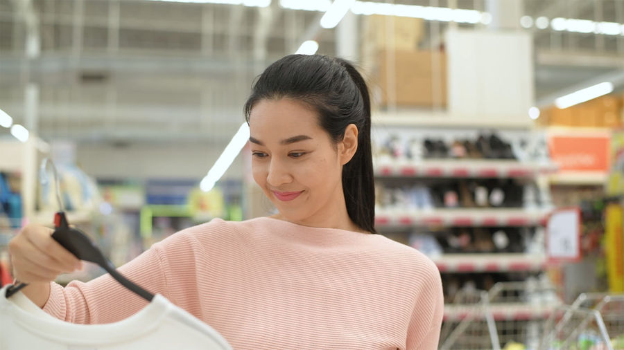 Portrait of smiling woman standing in store