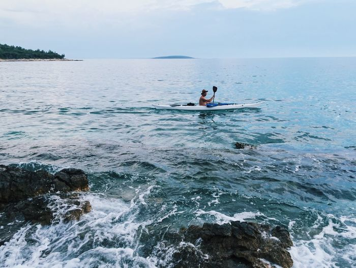 Adventure Aquatic Sport Beauty In Nature Kayak Kayaking Leisure Activity Lifestyles One Person Outdoor Pursuit Scenics Sea Sport Tranquility Vacations Water
