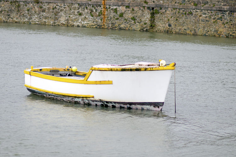 Water Nautical Vessel Transportation Waterfront Mode Of Transportation Day River No People Outdoors Moored Nature Yellow Wall Architecture Built Structure Motion Tranquility Rowboat