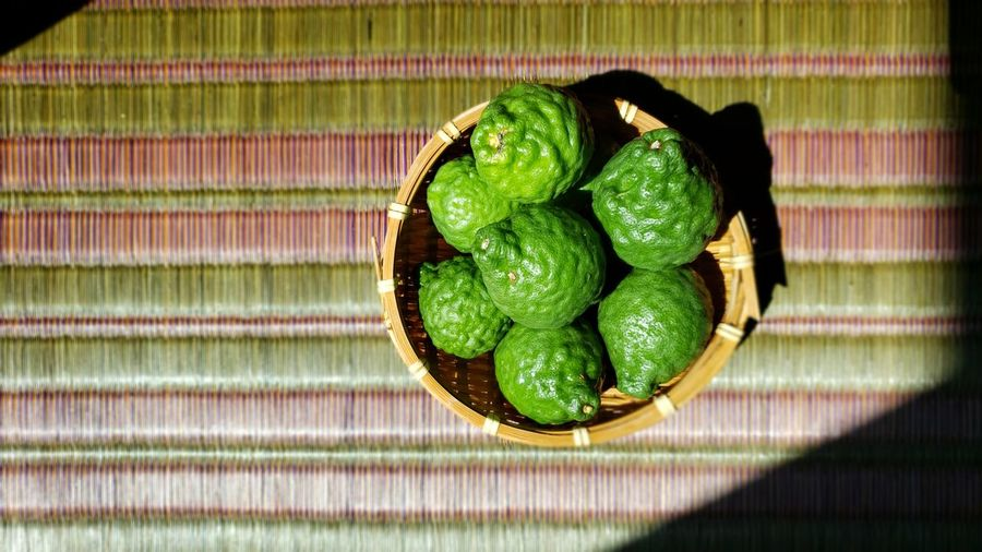 Directly above shot of green fruits in basket