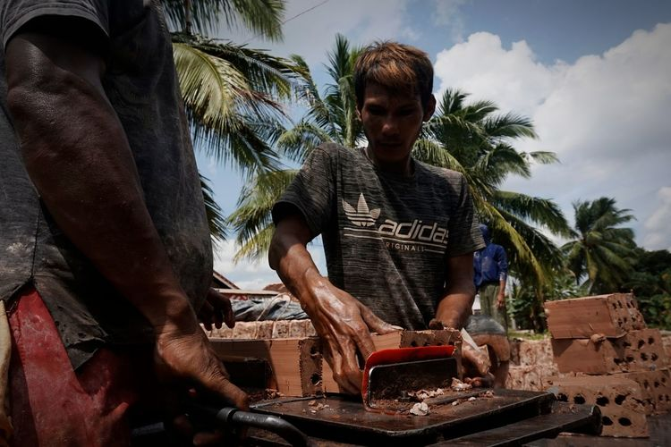 Man working on food