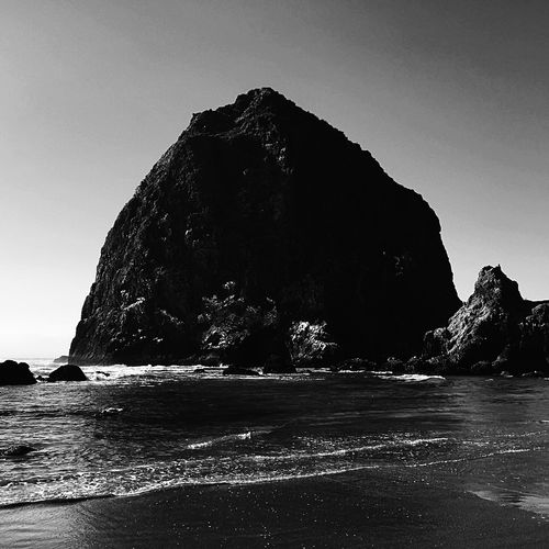 Canon beach, Oregon Sea Rock - Object Beauty In Nature Nature Rock Formation Water Scenics Tranquility Tranquil Scene Beach Clear Sky