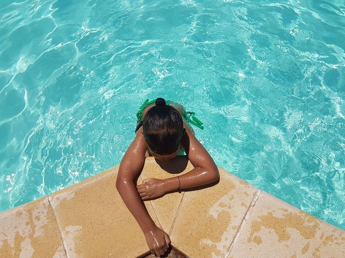 Rear view of young woman in swimming pool