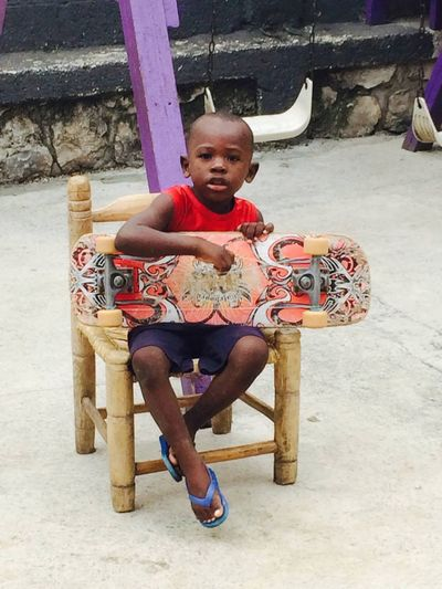 Little Man   in Port Au Prince Haiti Playing His Guitar . GLA God's Littlest Angels Orphanage 2014 Mission Trip Church Selfless Caring People And Places People & Places