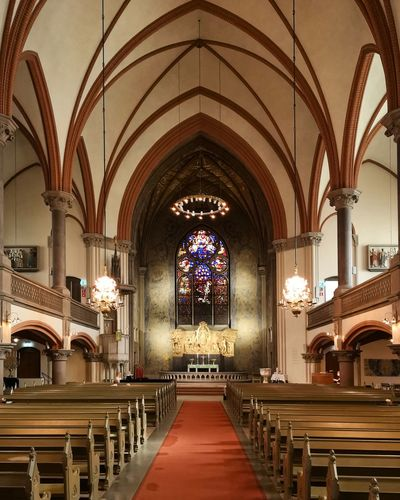 Aisle Altar Arch Architecture Architecture And Art Belief Building Built Structure Ceiling Empty Gothic Style In A Row Indoors  Lighting Equipment No People Pew Place Of Worship Religion Seat Spirituality