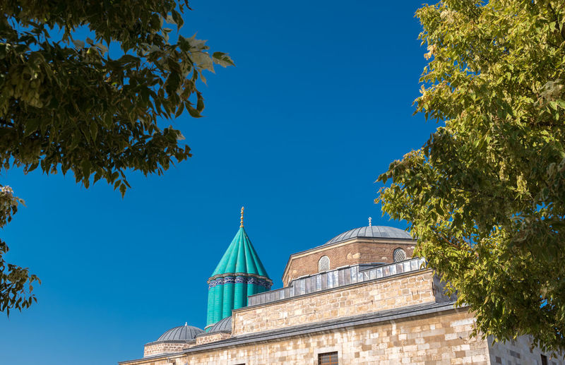 Mevlana museum in Konya,Turkey. Konya Mevlana Mevlana Mosque Mevlana Türbesi MevlanaRumi Mevlana Museum Turkey Sky Blue Tree Architecture Built Structure Low Angle View Building Exterior Nature No People Plant Day Sunlight Clear Sky Green Color Building Belief Growth Place Of Worship Religion Outdoors