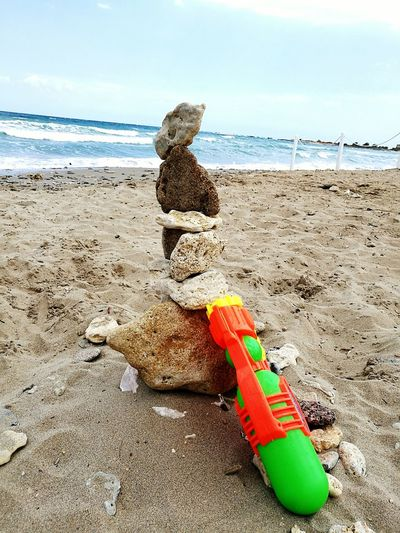 14 July 2016: Sometimes what seems impossible is possible. It's easy to find balance between peoples if only we want it. Honor and respect for the fallen in Manchester... Beach Gun Equilibrium Stones Stones Composition Stones In Equilibrium River Sea Peace ✌ Pease Manchester UK Toys Baby Toy Water Gun Pea