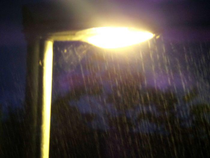 Close-up Dark Glowing Illuminated Llight. Night No People Rain. Raining... Selective Focus Street Lamp In The Rain. Street Lamp Lit Up Street Lamp. Wet. Yello.