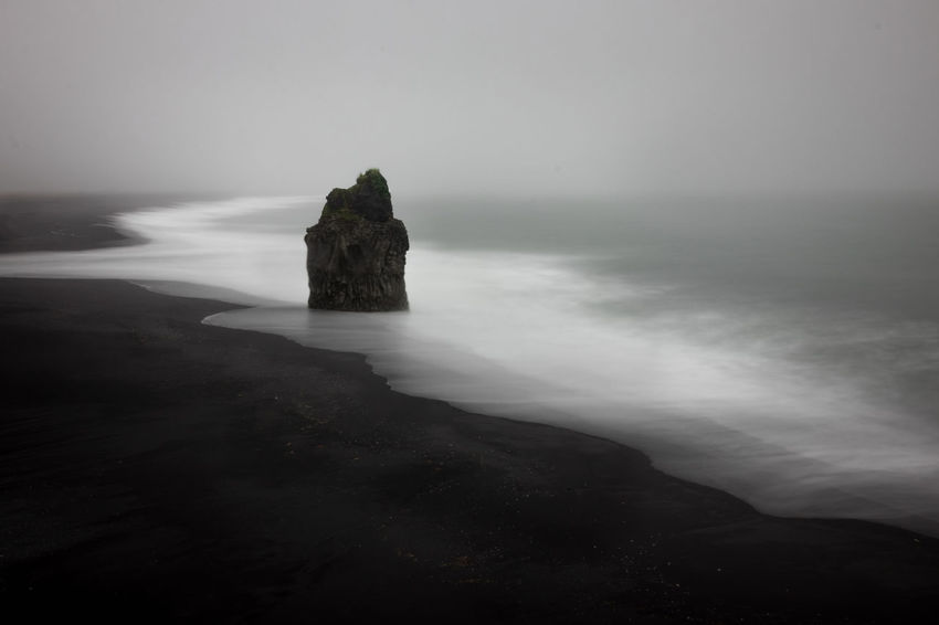 Dyrhólaey Iceland Iceland Memories Long Exposure Shot Vík í Mýrdal Beach Beauty In Nature Day Fog Foggy Foggy Morning Horizon Over Water Iceland_collection Long Exposure Nature No People Outdoors Rock - Object Scenics Sea Sky Tranquil Scene Tranquility Vik Water Shades Of Winter Go Higher My Best Travel Photo