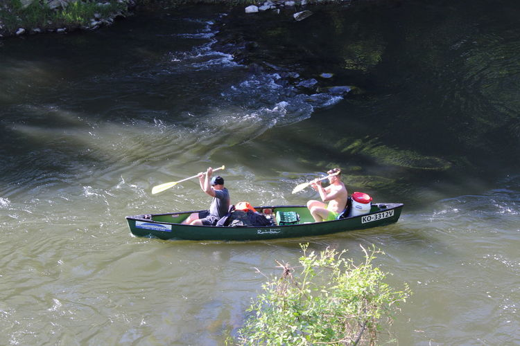 People in boat on river