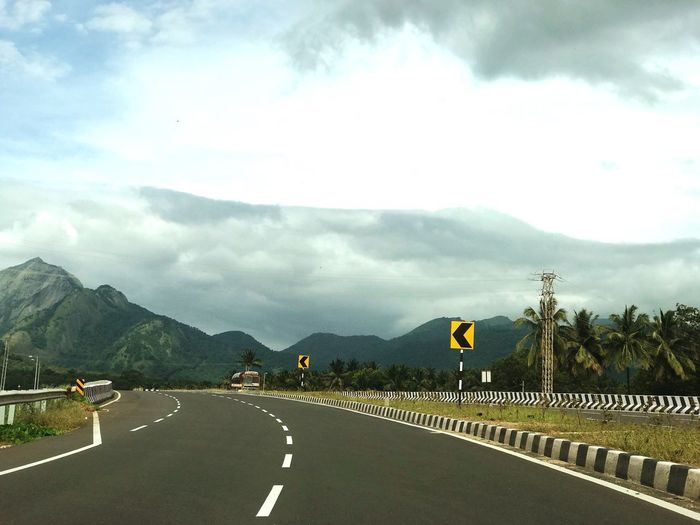 Driving down a scenic highway towards the hills in Kerala Tamilnadu border Sky The Way Forward Mountain Transportation Cloud - Sky Day Outdoors Nature Landscape Mountain Range Scenics No People Tamilnadu Beauty In Nature India Kerala