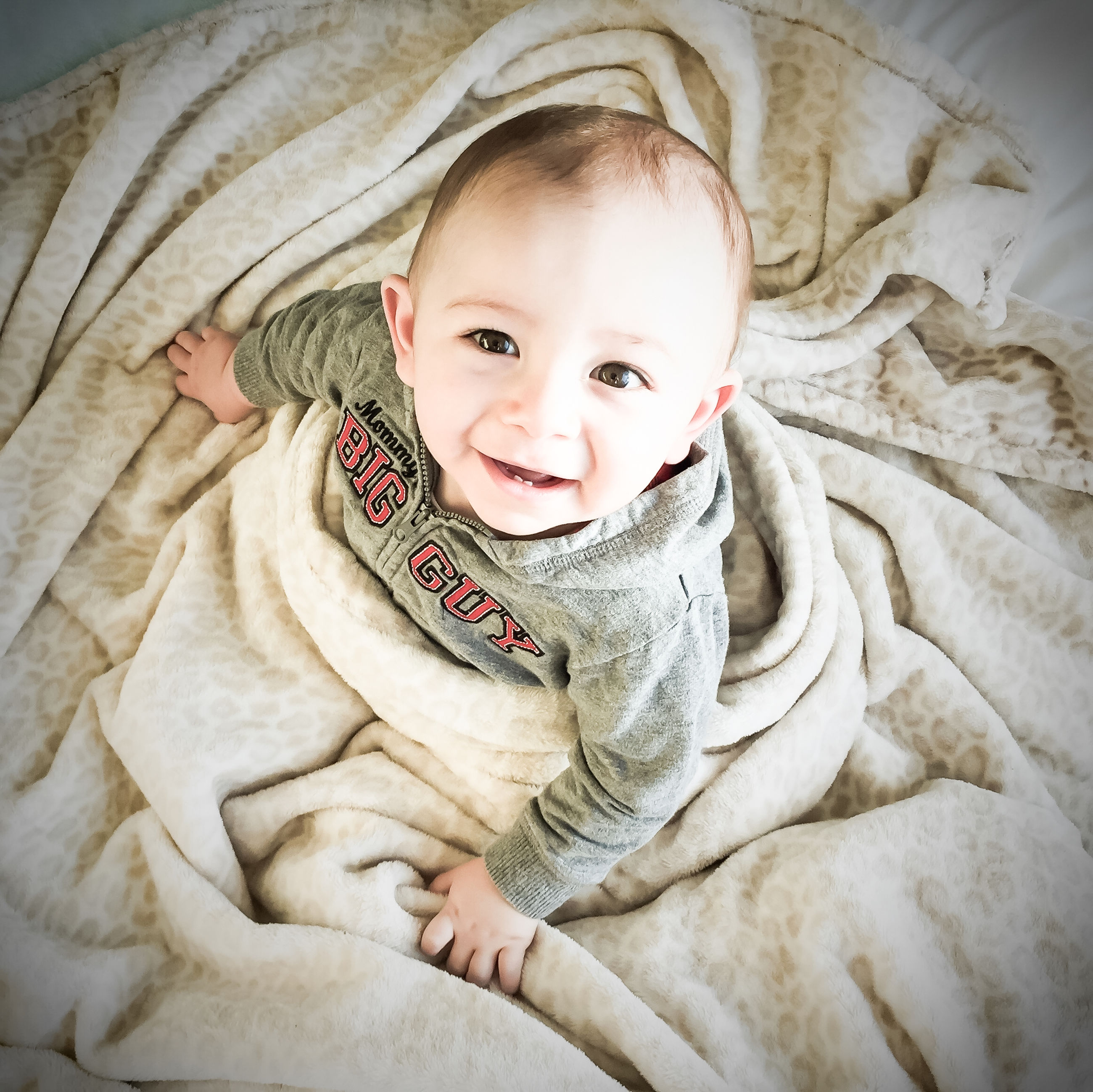 indoors, bed, relaxation, person, childhood, lying down, sleeping, cute, portrait, innocence, high angle view, looking at camera, home interior, resting, lifestyles, blanket, babyhood, toddler