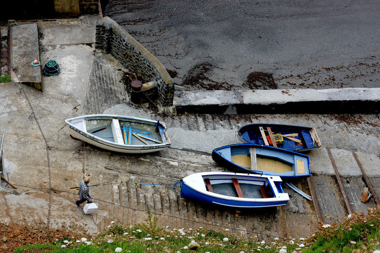 high angle view on a fisherman at the coast of Cornwall Alone Boat Boot Calm Coast Cornwall A Bird's Eye View Fischerman Fisherman Harmony High Angle View Idyllic Landscape Man Man At Work Nautical Outdoors Stillness Top Perspective Top View Transportation Travel Uk Water The Street Photographer - 2019 EyeEm Awards