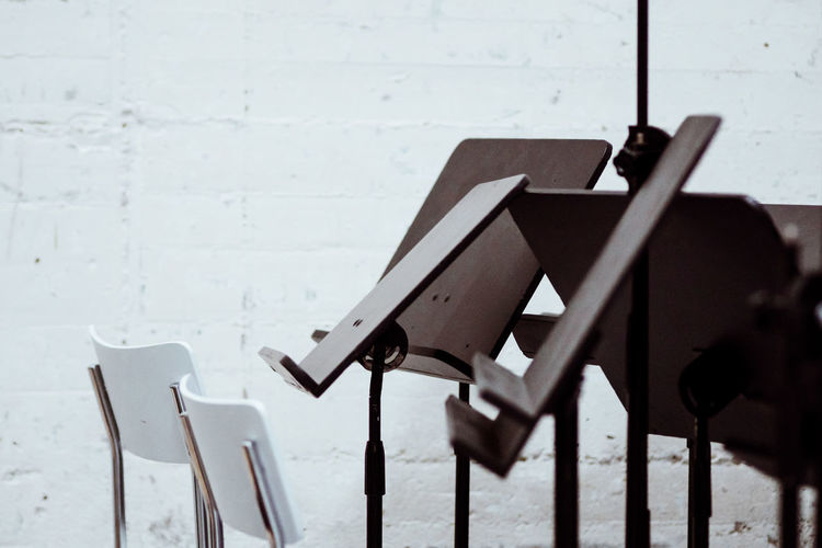 Chairs and music stands against wall