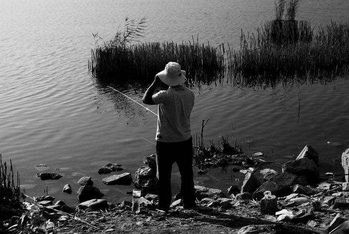 Fishing Lake Lifestyles Nature One Person Outdoors People Real People Rear View Standing Tranquility Water