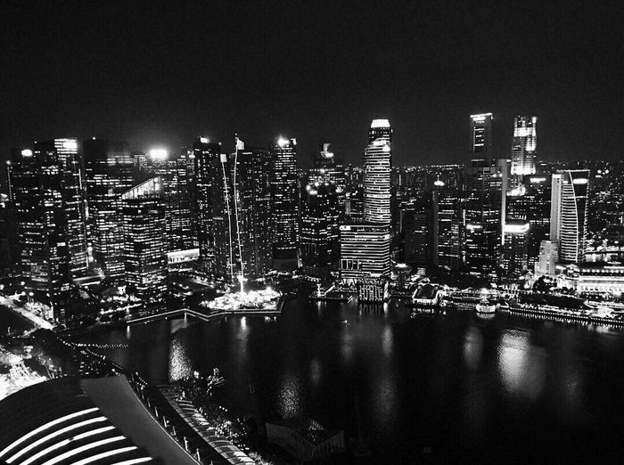 Architecture Building Exterior Built Structure Illuminated Cityscape City Night Skyscraper Modern No People Outdoors Sky Clear Sky Night View Of City Black And White Overlooking The Sea