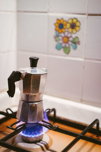 Coffee brewing on the stove Appliance Home Kitchen Domestic Room Domestic Kitchen Indoors  Stove No People Coffee Maker Tile Household Equipment Food And Drink Still Life Preparation  Close-up Espresso Maker Home Interior Burner - Stove Top Coffee Mokapot Espresso Italian Gas Stove Burner Brewing