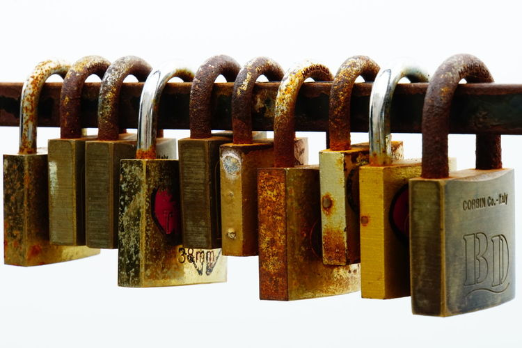 Close-up No People Outdoors Padlocks In A Row Rusted Love Locks Rusting Metal Security White Background