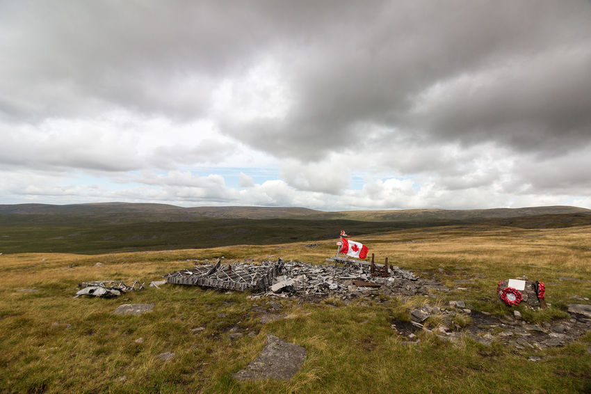 The wreckage of a Canadian crewed Wellington Bomber MF-509, on the Black Mountain in the Western Brecon Beacons Black Mountain Brecon Beacons Canadian Desolate MF-509 Mf509 Plane WW2 Memorial Wellington Bomber Cloud - Sky Crash Site Flag Landscape Mountain No People Outdoors Remote Scenics