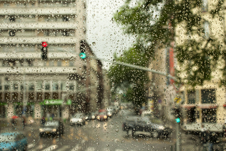 Backgrounds City City Street Close-up Day Drop Droplet Focus On Foreground Full Frame Glass - Material Land Vehicle Mode Of Transport Rain Rainy Season Season  Water Weather Wet Window Windshield