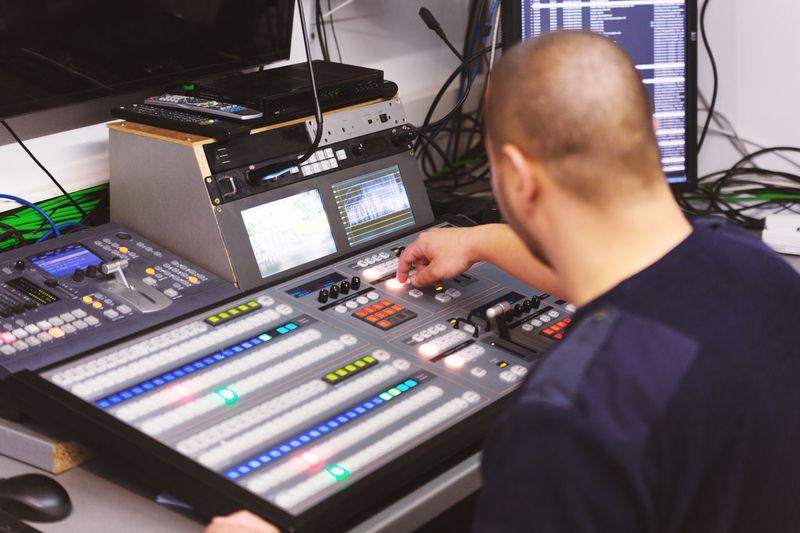 Close-up of man using sound mixer