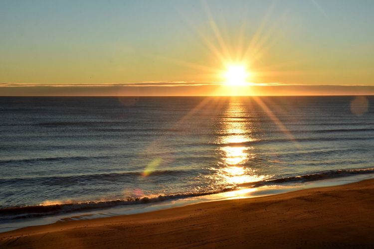 Sunrise Sunrise Over The Ocean Beach Sun Beauty In Nature Water Sea Motion Idyllic Tranquility Bright Lens Flare Tranquil Scene No People Sunlight Waves, Ocean, Nature Virginia Beach