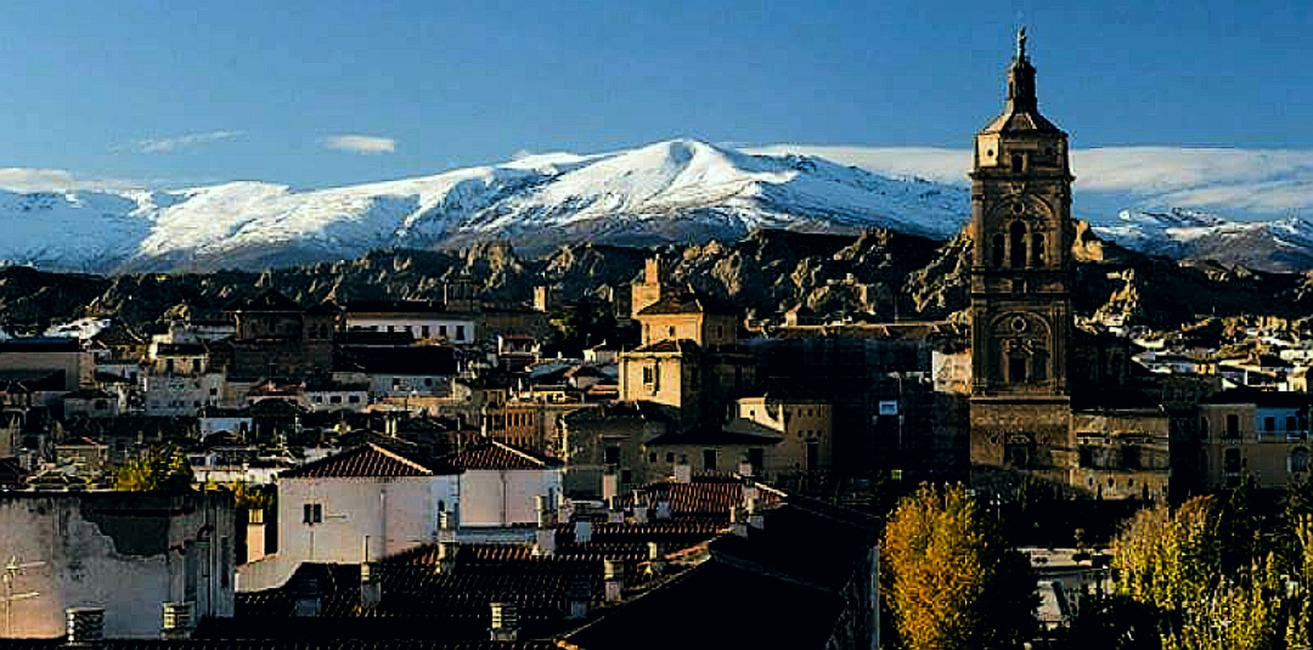 snow, city, winter, architecture, mountain, cityscape, building exterior, snowcapped mountain, travel destinations, built structure, travel, tradition, roof, cold temperature, town, landscape, place of worship, night, tower, mountain range, business finance and industry, outdoors, scenics, residential building, history, facade, apartment, mountain peak, snowing, sky, nature, no people, urban skyline, downtown district