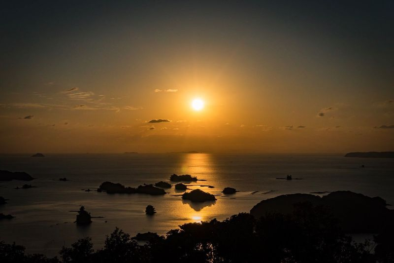 Sunset Sea Silhouette Sun Beauty In Nature Scenics Nature Horizon Over Water Orange Color Tranquil Scene Rock - Object Tranquility Water Sky Outdoors No People Tree Beach