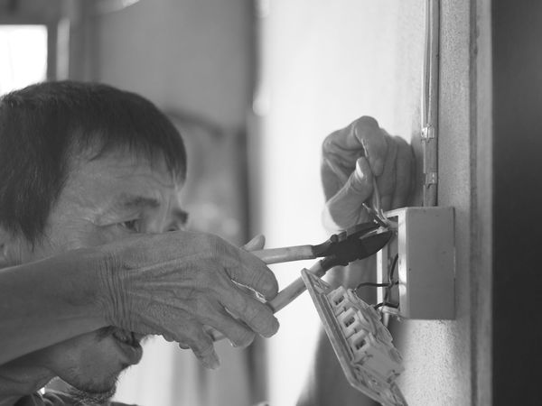 Adult Close-up Day Electric Wire Electrician  Human Body Part Human Hand Indoors  Men Occupation People Real People Repairing Skill  Work Tool Working Working