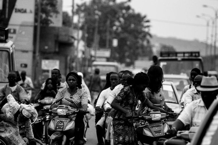 Women bikers in Mali Bikers Motorcycle Adult Day Focus On Foreground Large Group Of People Lifestyles Men Outdoors People Real People Technology Women Black And White Friday