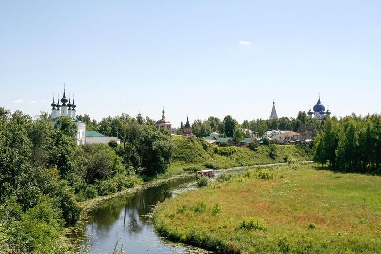 View of the river Kamenka Russia. Suzdal Boat Kamenka Trees Tree Clear Sky Outdoors No People Water River Golden Ring Russia Suzdal Blue Dome Religion Green Summer Landscape Panorama Churches Domes